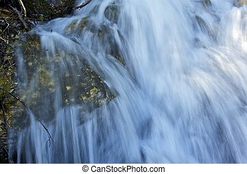 Waterfalls Closeup. Rapidly Running mountain Stream Water....