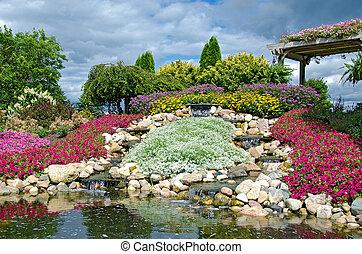 waterfalls in rock garden - Summer rock garden with...