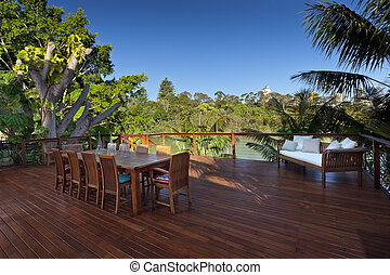 Outdoor entertaining deck with waterfront views