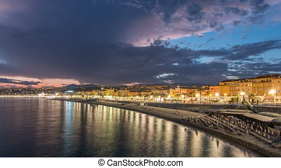 Waterfront of Nice city and Mediterranean Sea day to night timelapse