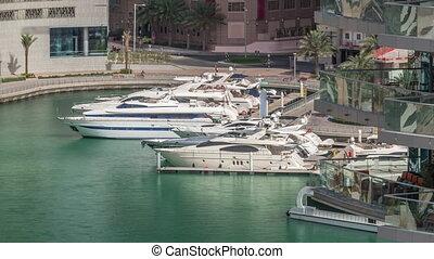 Waterfront promenade in Dubai Marina aerial timelapse. Dubai, United Arab Emirates