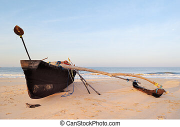 Waterfront - Wooden old fishing boat on the sandy shore
