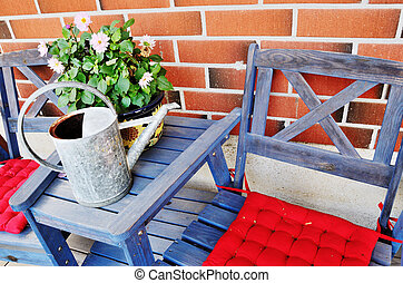 watering can and flower pot on the table