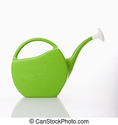 Watering can. - Green plastic watering can.