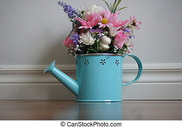 Watering can with Flowers.