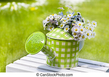 Watering can with flowers