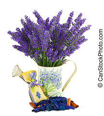 Watering can with lavender sachet on white