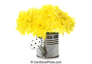 Watering can with yellow flowers