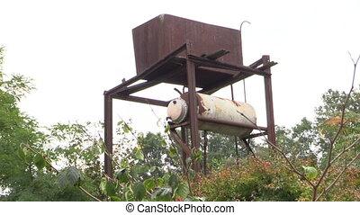 watering reservoir - Old rusty water reservoir tank for...