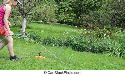 watering tool water spray - Gardener girl woman attach water...