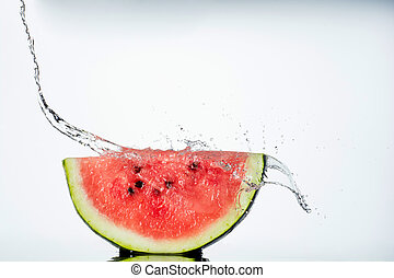 watermelon and water splash on white