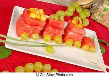Watermelon dessert - Watermelon, grapes and peaches in a ...