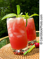 Watermelon drink - Two glasses of watermelon drink garnished...