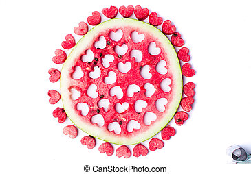Watermelon fruit with heart shaped cut outs