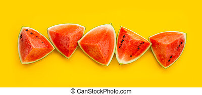 Watermelon on yellow background. Top view