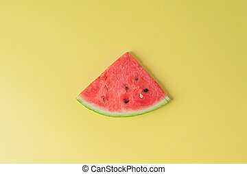 Watermelon piece on creative yellow background