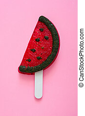 watermelon popsicle on pink background. Top view
