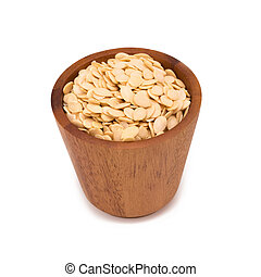 watermelon seeds in a wooden bowl isolated on white background