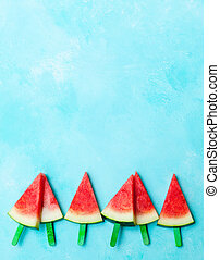 Watermelon slices on blue background. Top view. Copy space.