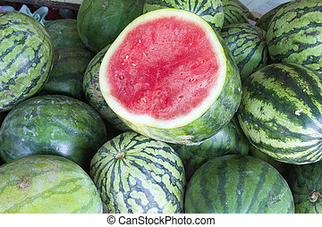 Watermelons Seedless Whole and Halved at Fruit Stand Closeup