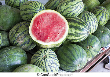 Watermelons Seedless Whole and Halved at Fruit Stand