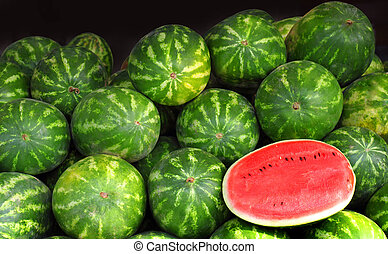 watermelons - Many big sweet green watermelons and one cut...