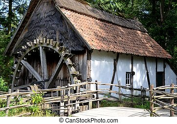 Ancient watermill in a museum in Belgium.