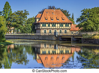 Watermill building with reflection in the water in Steinfurt