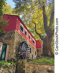 watermill of achileas in kalamas river,summer season, ioannina perfecture greece