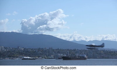 Waterplane taking off at Vancouver harbor with cargo...