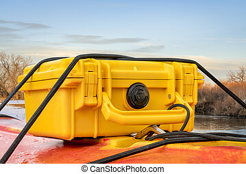 waterproof case on kayak deck