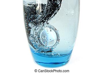Waterproof watch. - Waterproof watch in glass full of water...