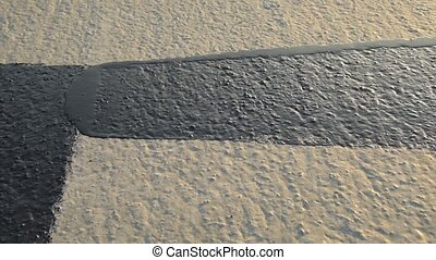 Worker applies bitumen mastic on the foundation - ...