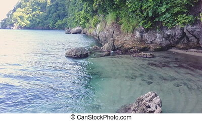 Waters and shore shot - A medium shot of waters and shore...