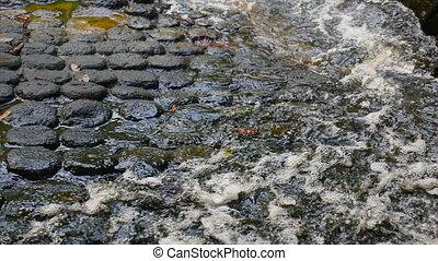 Waters flowing on rock