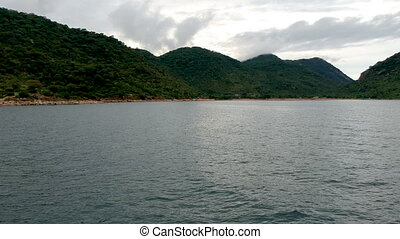 Waterscape of Lake Malawi with Green Hills in Background - ...