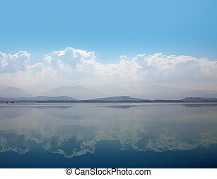 Waterscape of lake with cloudy sky reflection
