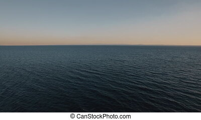 Waterscape with deep blue sea at sunset - Flying over deep...