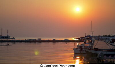 Waterscape with harbour and boats at sunset - Boats tied up...