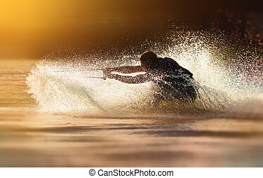 Waterskier waterskiing - Waterskier silhouette moving fast...