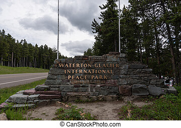 Waterton Glacier International Peace Park Sign along side of...