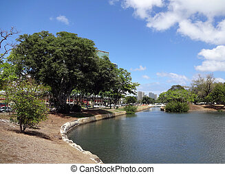 Waterway opens into pond in Ala Moana Beach Park surrounded ...