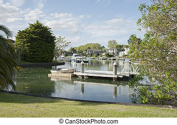 Waterway. - Waterway with jetty and residential homes.