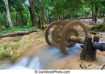 Waterwheel at Tad Sae Waterfalls at Luang prabang, Laos.