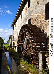 Waterwheel - Old restaured watermill. Italy. Prada. Mulino...