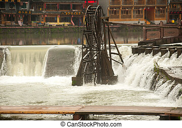 Waterwheel on the river . - Waterwheel on river at Fenghuang...