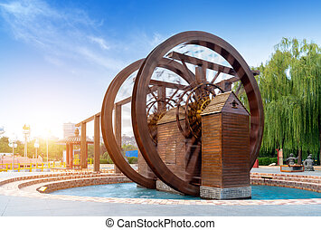 Waterwheel, rural China is an ancient tool used for irrigation.
