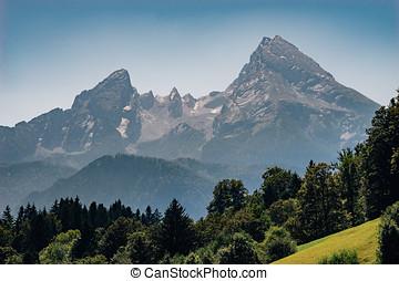 Watzmann mountain peak on hazy summer day, Bavarian Alps,...