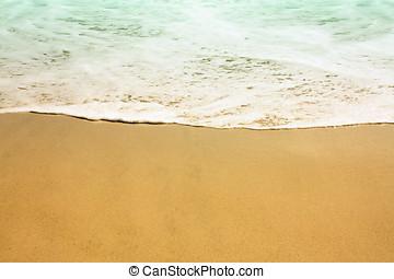 Wave and beach sand