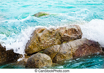 wave and stone in sea